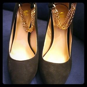 Black heels with gold chain ankle strap